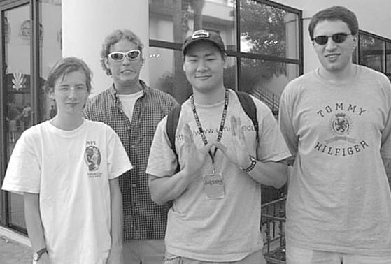 Seth McGann (L-R), Andrew Reiter, Dug Song, and Jan Koum are pictured at the DefCon hacker convention in Las Vegas, Nevada in this 1999 handout photo. WhatsApp co-founder Koum recently attended a reunion of his old security group, w00w00 in San Francisco, California February 26, 2014. REUTERS-Ejovi Nuwere-Handout via Reuters
