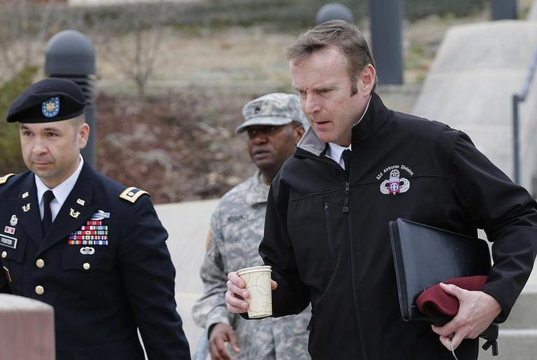 Brigadier General Jeffrey Sinclair (R), along with one of his attorneys, Maj. Sean Foster (L), leave the courthouse for the day at Ft. Bragg in Fayetteville, North Carolina March 5, 2014. REUTERS/Ellen Ozier