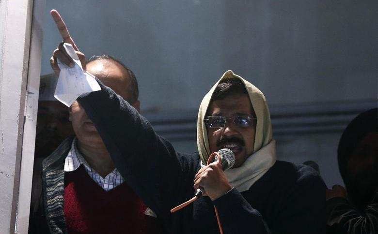 Delhi's Chief Minister Arvind Kejriwal, chief of the Aam Aadmi (Common Man) Party (AAP), addresses his supporters before announcing his resignation from his party headquarters in New Delhi February 14, 2014. REUTERS/Adnan Abidi