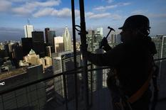 "A construction worker uses a hammer as he works on the ""ICE Condominiums"" development site by Cadillac Fairview and Lanterra Developments in Toronto December 14, 2012. REUTERS/Mark Blinch"