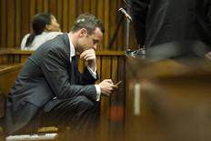 Olympic and Paralympic track star Oscar Pistorius sits in the dock during the fifth day of his trial for the murder of his girlfriend Reeva Steenkamp at the North Gauteng High Court in Pretoria, March 7, 2014. REUTERS/Theana Breugem/Pool