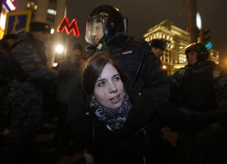 Punk protest band Pussy Riot member Nadezhda Tolokonnikova is detained by police at a protest in central Moscow February 24, 2014. REUTERS/Maxim Shemetov