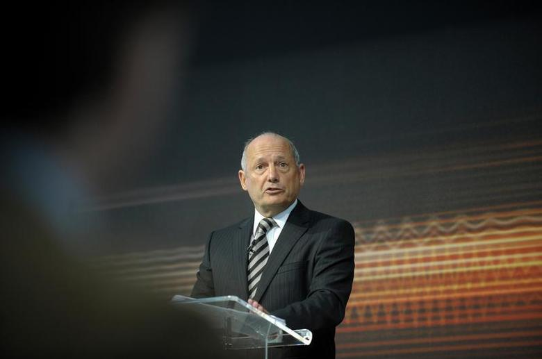 McLaren Automotive Executive Chairman Ron Dennis addresses the media at the official unveiling of the new MP4-12C road car at the McLaren Technology centre in Woking, southern England March 18, 2010. REUTERS/Kieran Doherty