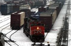 A Canadian National Railway Co. train reverses along one of the tracks at the CN MacMillan Yard in the north end of Toronto, February 20, 2004. REUTERS/Mike Cassese