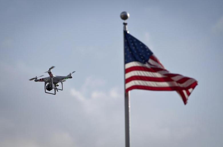 A small drone helicopter flies over Coney Island in New York August 29, 2013. REUTERS/Carlo Allegri
