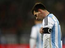 O argentino Lionel Messi durante partida com a Romênia na quarta-feira, em Bucareste. 05/03/2014 REUTERS/Bogdan Cristel