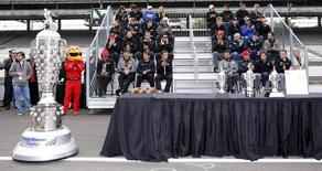 Drivers listen to instructions during the drivers meeting for the Indianapolis 500 at the Indianapolis Motor Speedway in Indianapolis, Indiana May 25, 2013. REUTERS/Jeff Haynes