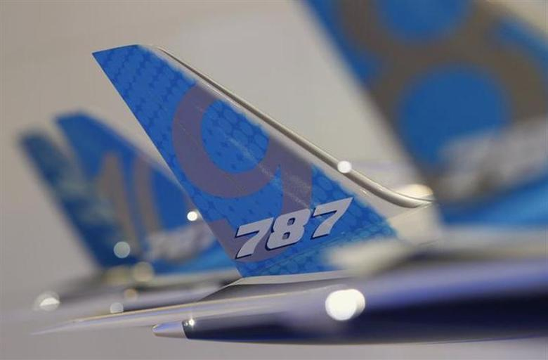 The tailwing of a model Boeing 787 Dreamliner aircraft is pictured at the Boeing booth at the Singapore Airshow February 11, 2014. REUTERS/Edgar Su/Files