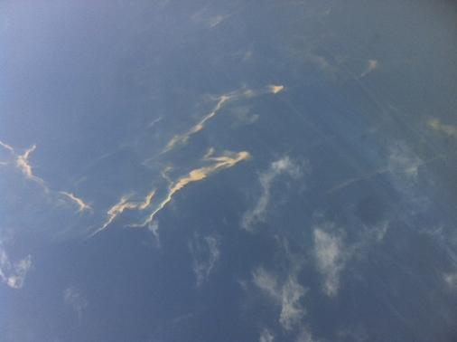 An aerial view of an oil spill is seen from a Vietnamese Air Force aircraft in the search area for a missing Malaysia Airlines plane, 250 km from Vietnam and 190 km from Malaysia, in this handout photo from Thanh Nien Newpaper taken on March 8, 2014. REUTERS-Trung Hieu-Thanh Nien Newspaper