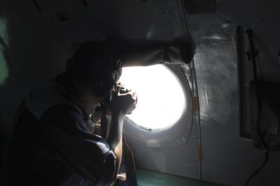 Malaysian plane presumed crashed; questions over false...