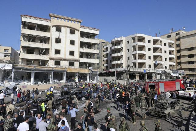 Civil defence members, army soldiers and police officers gather at the site of an explosion near Iran's cultural centre in the southern suburbs of Beirut February 19, 2014. REUTERS/Hasan Shaaban