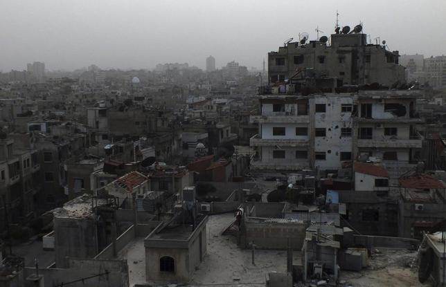 A general view of damaged buildings are seen in the besieged area of Homs March 3, 2014. REUTERS/Yazan Homsy