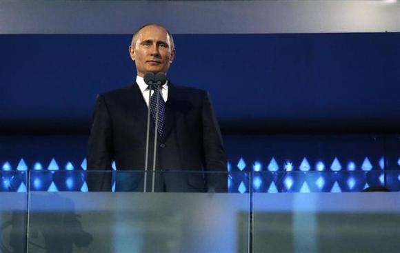 Russia's President Vladimir Putin attends the opening ceremony of the 2014 Paralympic Winter Games in Sochi, March 7, 2014. REUTERS/Alexander Demianchuk