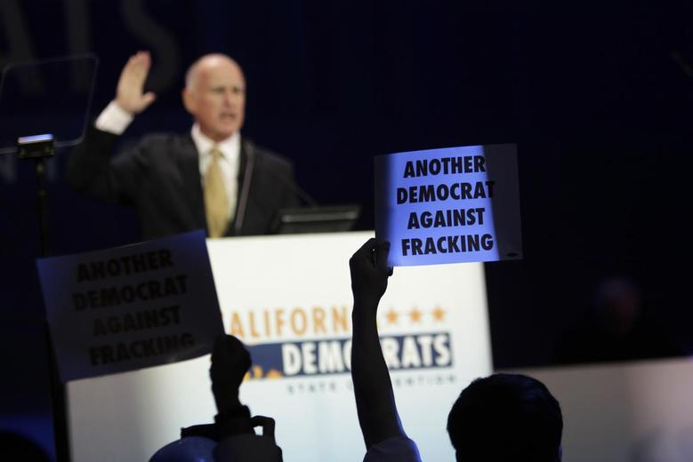 Members of the Democratic Environmental Caucus and other environmental organizations demonstrate against hydraulic fracturing oil extraction, or fracking, as California Governor Jerry Brown speaks at the 2014 California Democrats State Convention at the Los Angeles Convention Center in Los Angeles, California, March 8, 2014. REUTERS/David McNew