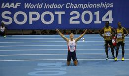 Richard Kilty of Britain celebrates victory next to Jamaicans Nesta Carter and Kimmari Roach in the men's 60 metres final at the world indoor athletics championships at the ERGO Arena in Sopot March 8, 2014. REUTERS/Kai Pfaffenbach