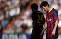 Barcelona's Lionel Messi reacts during his team's Spanish first division soccer match against Valladolid at Jose Zorilla stadium in Valladolid March 8, 2014. REUTERS/Sergio Perez