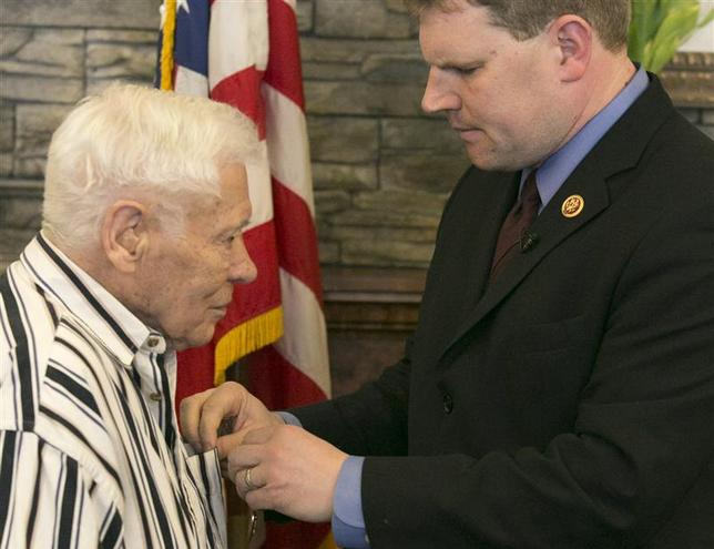 World War II veteran Richard ''Dick'' Faulkner (L), is presented the Purple Heart by U.S. Representative Dan Maffei during a ceremony in Auburn, New York March 8, 2014. REUTERS/Mike Bradley