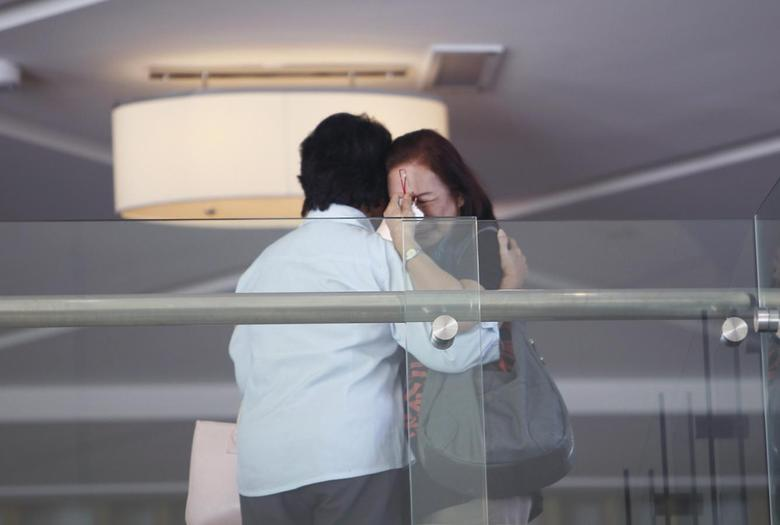 Family members of those onboard the missing Malaysia Airlines flight MH370 cry at a hotel in Putrajaya March 9, 2014. REUTERS/Samsul Said