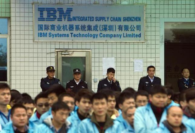 IBM workers protest at an IBM factory in Shenzhen, Guangdong province, March 7, 2014. REUTERS/Alex Lee