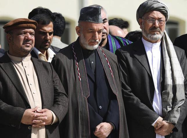 Afghan President Hamid Karzai (C) and Vice Presidents Mohammad Qasim Fahim (L) and Karim Khalili attend the funeral ceremony of slain former president Burhanuddin Rabbani, at the presidential palace in Kabul, September 23, 2011. REUTERS/S.Sabawoon/Pool