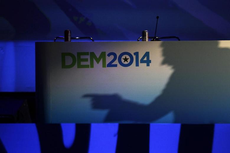 California Lt. Governor Gavin Newsom casts a shadow on a banner as he speaks at the 2014 California Democrats State Convention at the Los Angeles Convention Center March 8, 2014. REUTERS/David McNew
