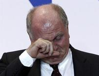 File photo of Bayern Munich's President Uli Hoeness reacting during an annual meeting of the German Bundesliga first division soccer club in Munich November 13, 2013. REUTERS/Michaela Rehle/Files