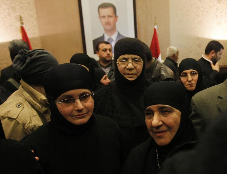 Nuns, who were freed after being held by rebels for over three months, arrive at the Syrian border with Lebanon at the Jdaydeh Yaboos crossing, early March 10, 2014. REUTERS/Khaled al-Hariri