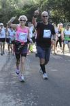 Lee Jordan (R) and his wife Beth run the Disney Half Marathon in Orlando, Florida, in this handout photo taken on January 12, 2013.REUTERS/FullestLiving.com/Handout via Reuters