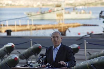 Netanyahu, showing seized rockets, says Iran fooling...