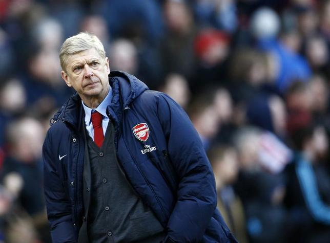 Arsenal manager Arsene Wenger walks off the pitch following their English Premier League soccer match defeat to Stoke City at the Britannia stadium in Stoke-on-Trent, central England March 1, 2014. REUTERS/Darren Staples