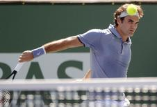 Mar 10, 2014; Indian Wells, CA, USA; Roger Federer (SUI) in his third round match against Dmitry Tursunov (RUS) during the BNP Paribas Open at the Indian Wells Tennis Garden. Federer won 7-6, 7-6. Mandatory Credit: Jayne Kamin-Oncea-USA TODAY Sports - RTR3GI6B