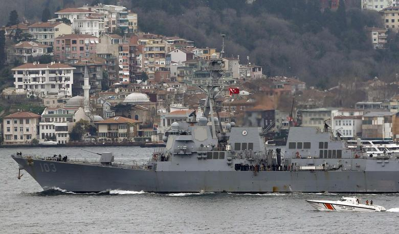 U.S. Navy guided-missile destroyer USS Truxtun is escorted by a Turkish Navy Coast Guard boat as it sets sail in the Bosphorus, on its way to the Black Sea March 7, 2014. REUTERS/Murad Sezer