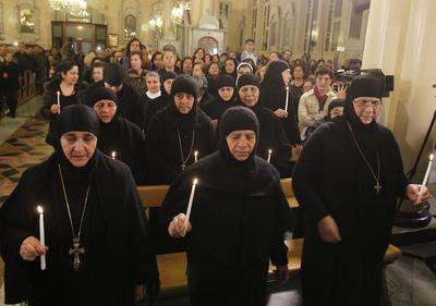 Freed nuns reach Damascus as prisoner exchange continu...
