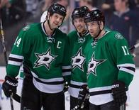 Mar 6, 2014; Dallas, TX, USA; Dallas Stars center Tyler Seguin (91) celebrates his hat trick with left wing Jamie Benn (14) and center Rich Peverley (17) against the Vancouver Canucks at the American Airlines Center. Jerome Miron-USA TODAY Sports
