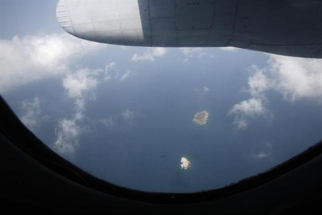 A general view from an AN-26 aircraft from the Vietnamese airforce, during a mission to find the missing Malaysia Airlines flight MH370, shows Tho Chu island March 11, 2014. REUTERS/Kham
