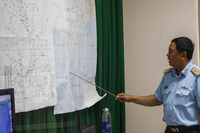 Deputy commander of Vietnam Air Force Do Minh Tuan points to a map during a news conference after their mission to find the missing Malaysia Airlines flight MH370 at Phu Quoc Airport on Phu Quoc Island March 11, 2014. REUTERS/Athit Perawongmetha