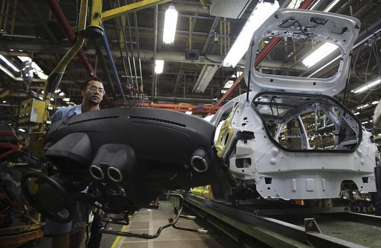 A Brazilian worker assembles a Ford car on an assembly line at Sao Bernardo do Campo Ford plant, near Sao Paulo August 13, 2013. REUTERS/Nacho Doce