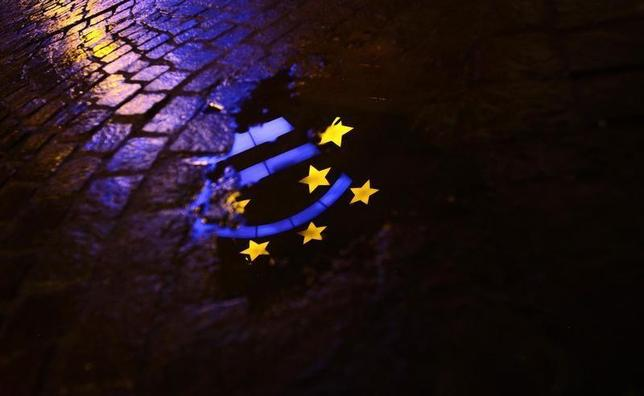 The Euro sculpture is partially reflected in a puddle on a cobblestone pavement in front of the headquarters of the European Central Bank (ECB) in Frankfurt January 21, 2012. REUTERS/Kai Pfaffenbach
