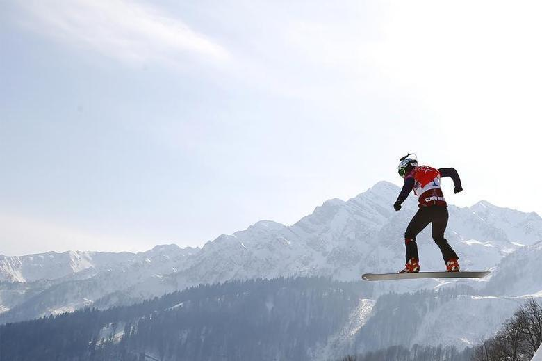 Eva Samkova of the Czech Republic competes during the women's snowboard cross finals at the 2014 Sochi Winter Olympic Games in Rosa Khutor February 16, 2014. REUTERS/Lucas Jackson