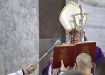 Pope Francis celebrates mass during Ash Wednesday at Santa Sabina Basilica in Rome March 5, 2014. REUTERS/Max Rossi