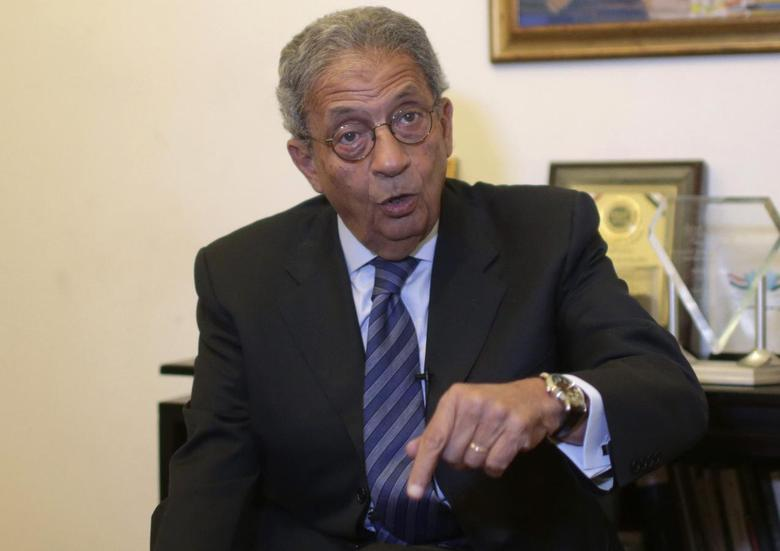 Former foreign minister and presidential candidate Amr Moussa speaks during an interview with Reuters in Cairo March 11, 2014. REUTERS/Asmaa Waguih