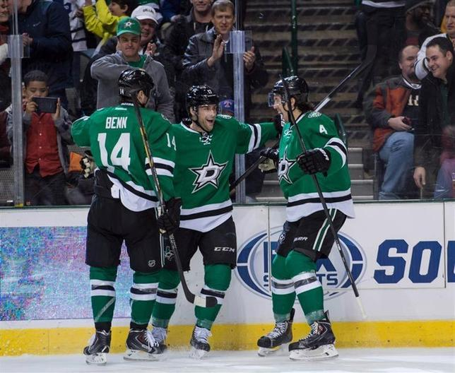 Jan 23, 2014; Dallas, TX, USA; Dallas Stars left wing Jamie Benn (14) and center Rich Peverley (17) and defenseman Brenden Dillon (4) celebrate Peverleys goal against the Toronto Maple Leafs during the second period at the American Airlines Center. The Stars defeated the Maple Leafs 7-1. Mandatory Credit: Jerome Miron-USA TODAY Sports - RTX17RZK