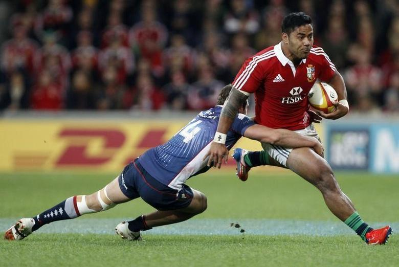 British and Irish Lions player Manu Tuilagi (R) is tackled by Tom English from the Melbourne Rebels during their rugby game in Melbourne June 25, 2013. REUTERS/Brandon Malone