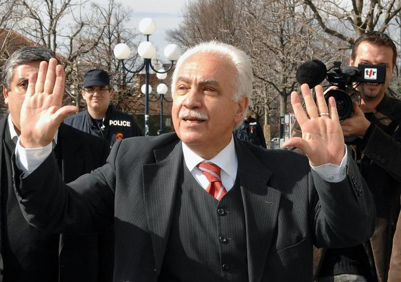 Turkish politician Dogu Perincek waves to supporters outside the court in Lausanne March 6, 2007. REUTERS/Jean Bernard Sieber/ARC