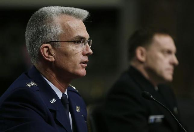 U.S. Navy Vice Admiral Michael Rogers (R) and U.S. Air Force General Paul Selva attend the Senate Armed Services Committee confirmation hearing on Capitol Hill in Washington March 11, 2014. REUTERS/Gary Cameron