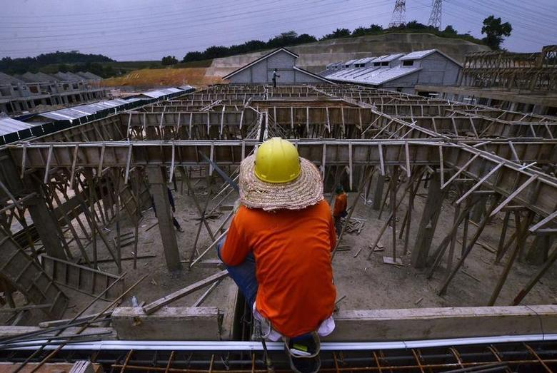 A construction worker rests on a rooftop at a housing construction project area in Bukit Raja Klang outside Kuala Lumpur February 13, 2014. REUTERS/Samsul Said