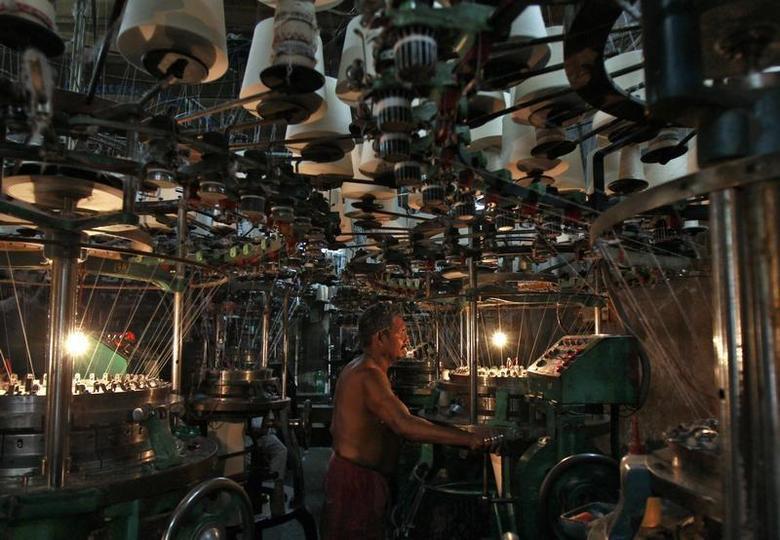 An employee works inside an undergarment factory in Kolkata March 10, 2014. REUTERS/Rupak De Chowdhuri