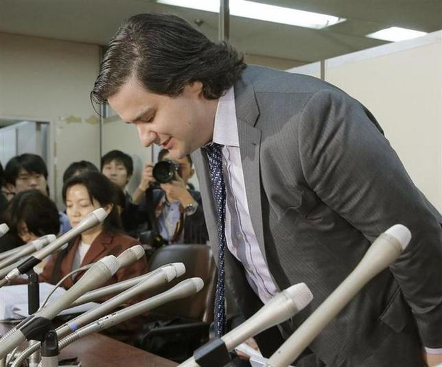 Mark Karpeles, chief executive of Mt. Gox, bows at the start of a news conference at the Tokyo District Court in Tokyo, in this photo taken by Kyodo February 28, 2014. REUTERS/Kyodo