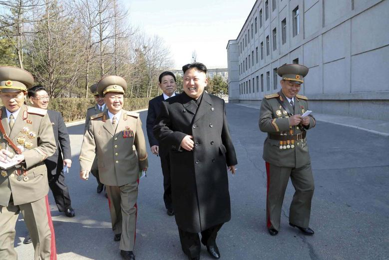 North Korean leader Kim Jong Un (C) visits the Kim Il Sung University of Politics to take part in the election of a deputy to the Supreme People's Assembly at sub-constituency No. 43 of Constituency No. 105 together with service personnel of the KPA on March 9, 2014 in this photo released by North Korea's Korean Central News Agency (KCNA) in Pyongyang. REUTERS/KCNA