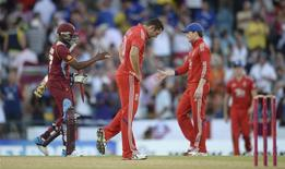 England's Tim Bresnan reacts after the West Indies won their second T20 international cricket match at Kensington Oval in Bridgetown, Barbados March 11, 2014. REUTERS/Philip Brown